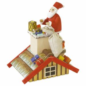 Rauchhaus mit Weihnachtsmann auf dem Dach